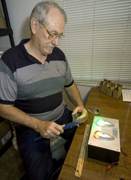Bob Perigo tests equipment. LED lights for planes are some of the company's best-selling items